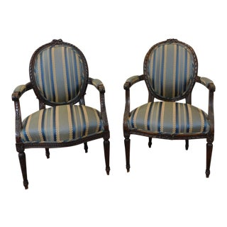 1950s French Louis XVI Carved Walnut Armchairs - a Pair