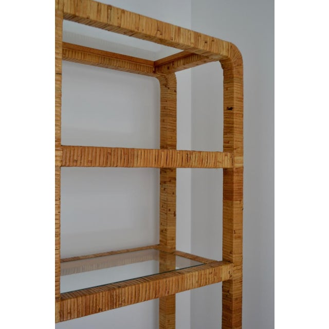 Striking Mid-Century rattan etagere, circa 1960s-1970s. This sculpturally designed rattan wrapped hardwood bookcase /...
