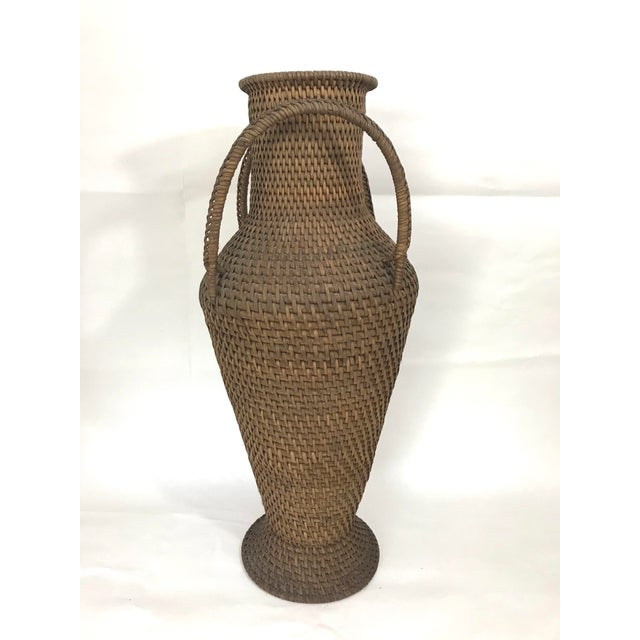 Intricately hand woven Hapao Tribal (Philippines) rattan urn/vase. Two good sized handles and a sturdy foot. The original...