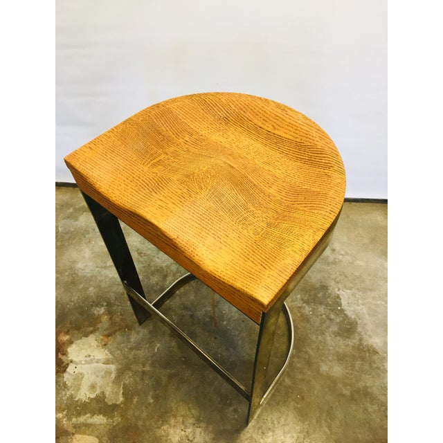 "A vintage bar stool made by Warren Bacon. It measures 17.75"" wide x 15"" deep x 28.5"" tall. It has a solid sculpted Oak..."