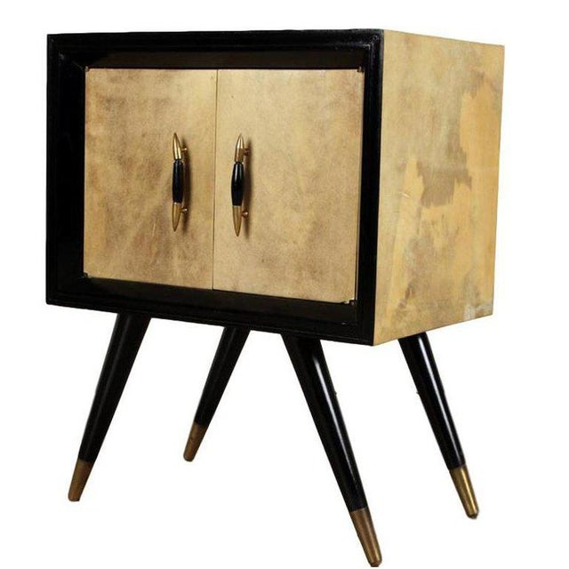 Pair mid-century modern ebonized wood and parchment side cabinets with bronze sabots After Robsjohn-Gibbings, American,...