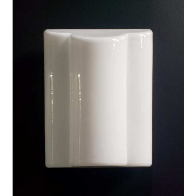 """Italian modern wall sconce manufactured by Leucos, c.1970s-1980s, white, tapered tubular glass shade. Measures 11.5"""" high..."""