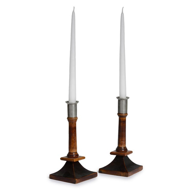 A pair of Swedish birch, stained birch and pewter candlesticks, Late 19th Century, of classic form with tapered square...