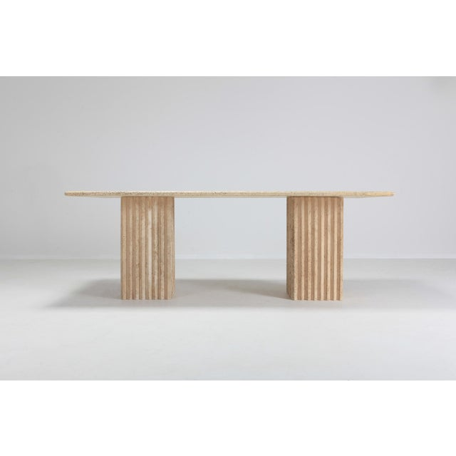 Postmodern piece in travertine marble that can be used as a writing desk or dining table. Fits 6 to 8 persons. The two...