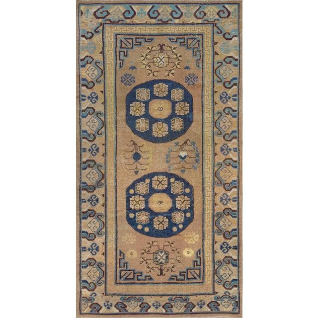 Antique Handwoven Wool Persian Khotan Runner For Sale