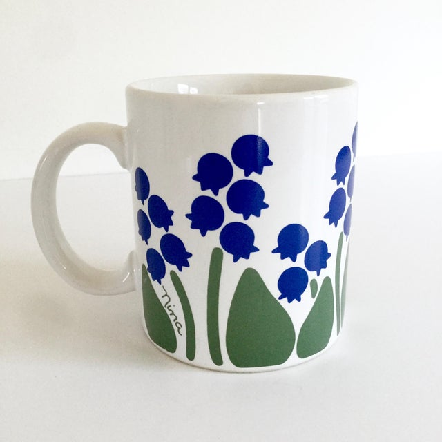 A lovely, early 1980s collectible floral motif coffee mug from Anchor Hocking's Greenhouse Collection. This glazed ceramic...