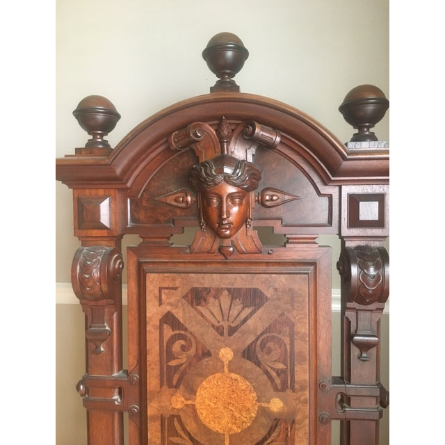 Beautiful vintage hand carved mahogany Kings Chair with detailed wood inlay. This oversized chair is definitely a...
