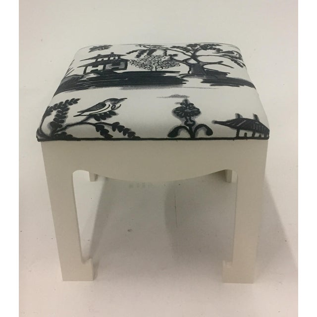 Two 1970s glamorous ottomans with warm white painted wood bases and vintage black and white block printed Scalamandre fabric.