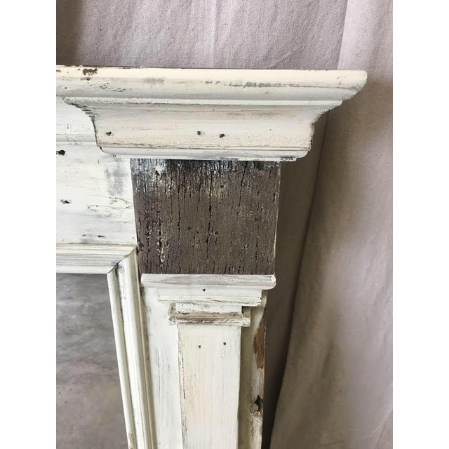 Scandinavian floor mirror with side columns and antique white paint. This handsome mirror is made of reclaimed antique...