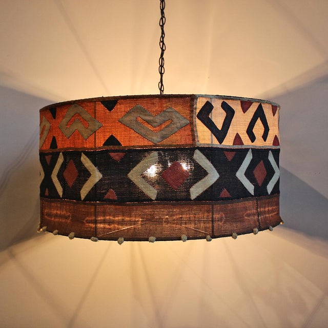 Original African Kuba Cloth drum shaped chandelier light. Each piece made with a unique Kuba cloth. No two are alike.