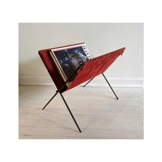 Foldable vintage magazine/book rack made out of red suede and black iron frame. Weave and scallop detail along top edge....