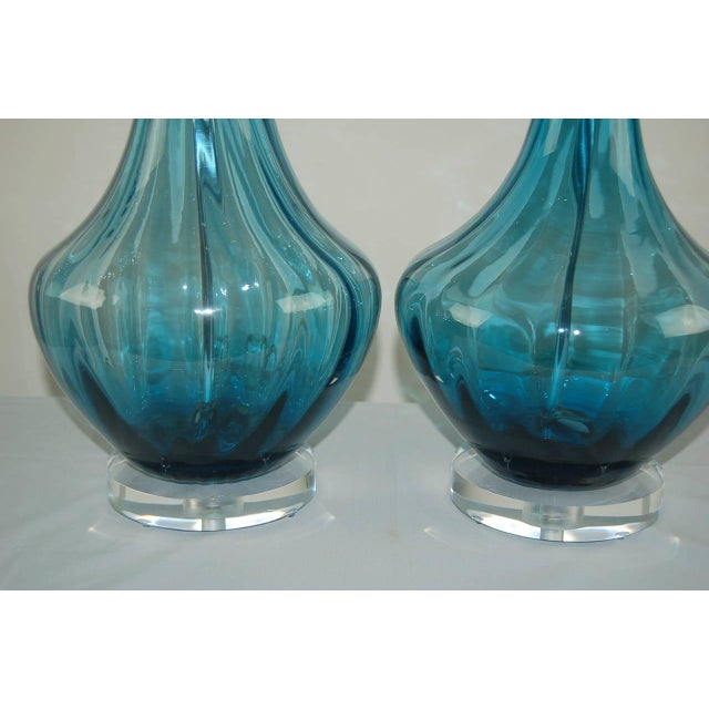 Matched pair of Italian TEAL BLUE Petticoat lamps with vertical optics. The color of the glass and clarity of same are...