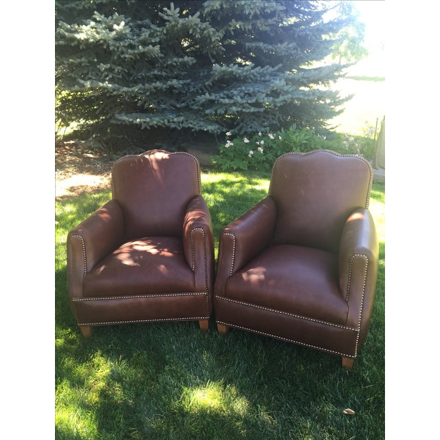 Offered is a pair of gorgeous oak designer lounge chairs made by Cisco Brothers. These custom designer lounge chairs in...