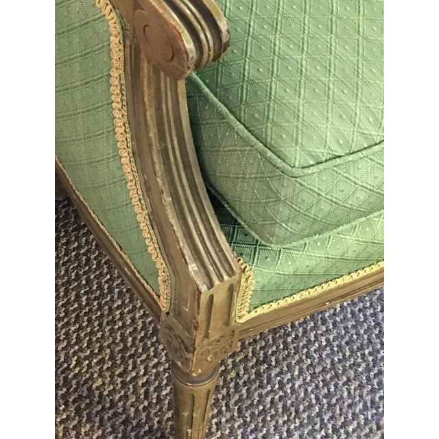 A pair of Maison Jansen stamped Louis XVI style armchairs with new green upholstery. Wonderfully distressed. This fine...