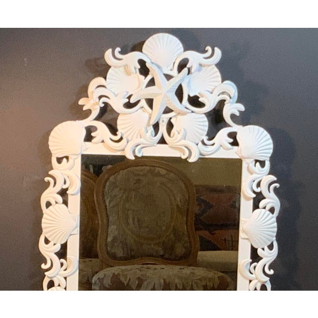 Exceptional mirror made of iron, artistically decorated with seashells and sea star motifs, painted with white flat...