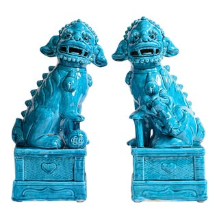 Chinese Glazed Ceramic Peking Blue Foo Dogs, A - a Pair