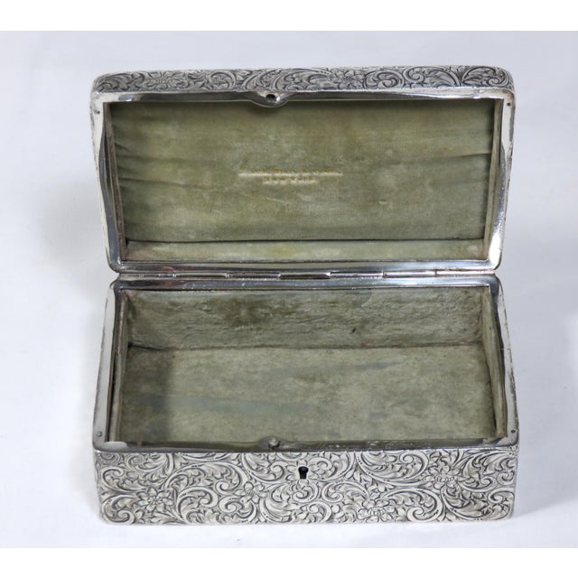 A Fine Quality American Sterling Silver Jewelry Box with Fancy Allover Hand Engraved Decorations. Sold by Black Starr &...