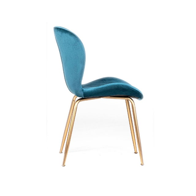 Blue velvet upholstered dining chair with brass finish metal legs. Unique and stylish pop of color for around your dining...