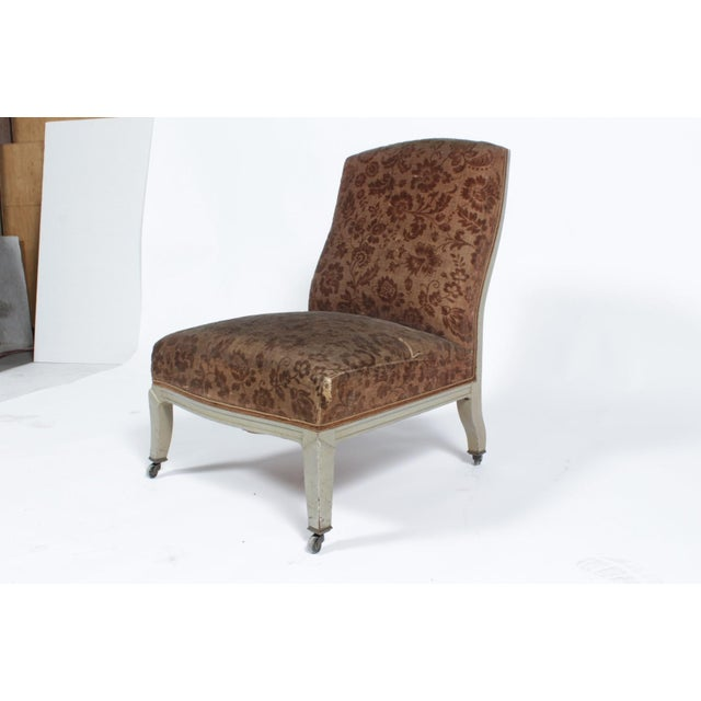 Napoleon III floral upholstered side chair. The chair sits low in a slight reclining position and features cabriole legs,...