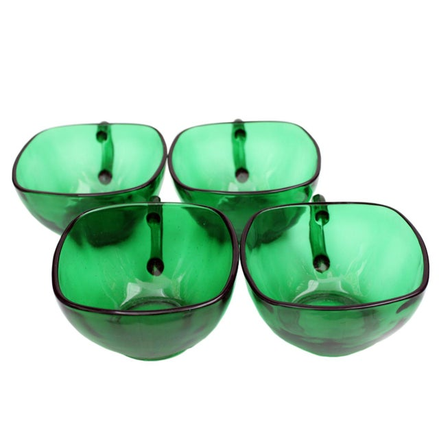 A set of 4 emerald green tea cups in good condition.