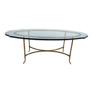 Elegant Mid-Century Modern Brass Base Coffee Table With a Sculpted Glass Top For Sale