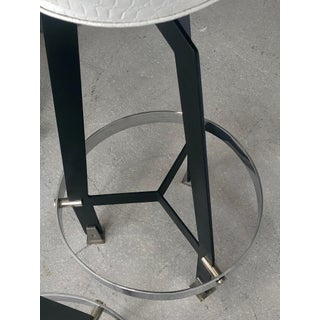 Pair of Mid-Century Modern Stainless Steel and Black Enamel Barstools Preview