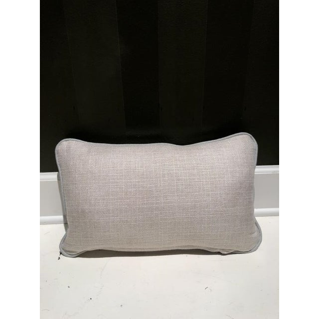 The TP1118 Throw Pillow is a first quality showroom sample that features an off-white fabric with a fiberdown fill.