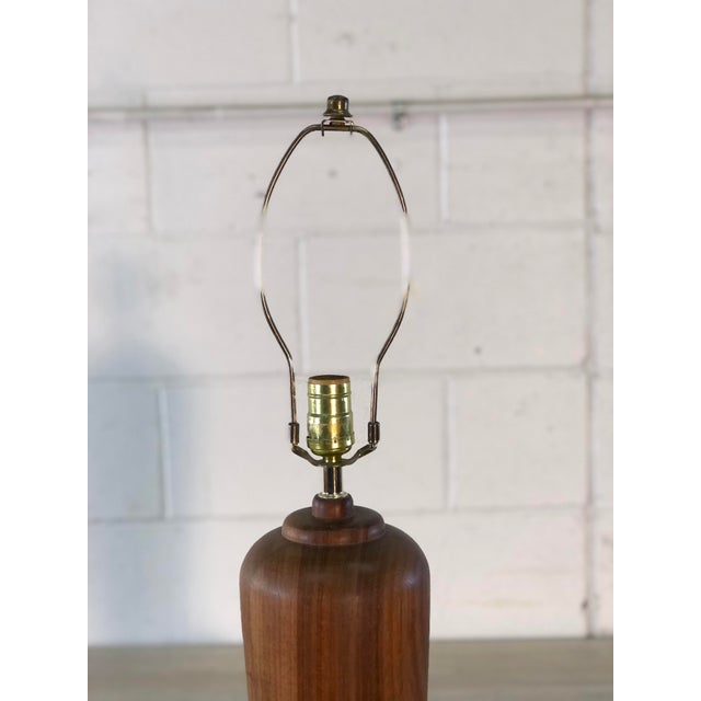 """Vintage 1970s teak wood Scandinavian style cylindical table lamp. Wired for the US and in working condition. Socket, 19""""H...."""
