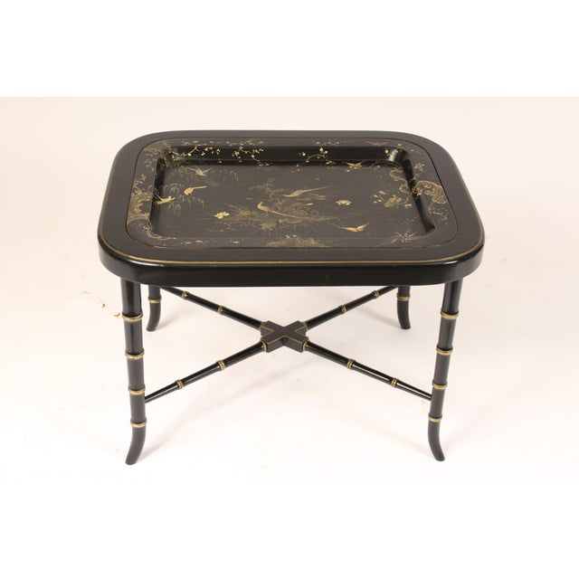 English regency style paper mache tray table on a regency style bamboo turned wood base. The paper mache tray decorated...