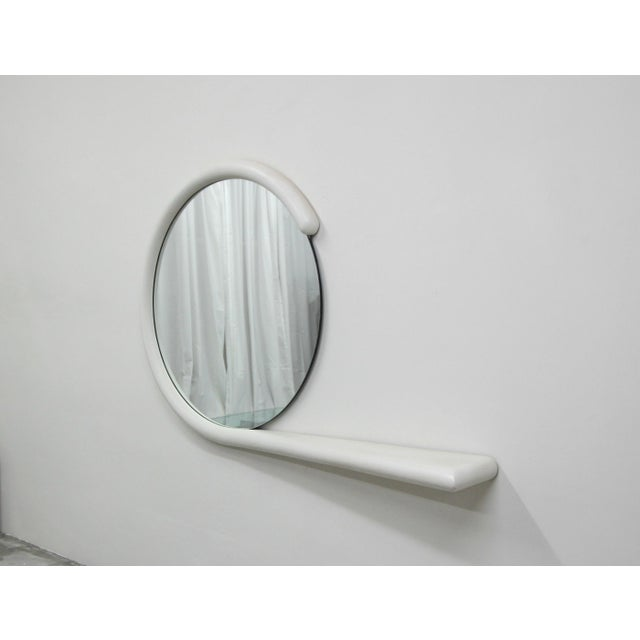 Unique post modern, hanging wall mirror with attached console shelf by Jay Spectre. Has very modern appeal that can mesh...