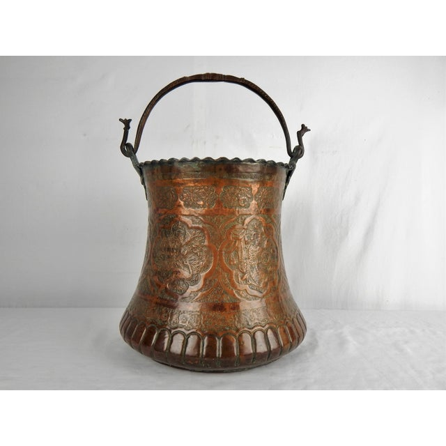 Large Moorish decorative pail with hammered iron handle terminating in dragon heads. Hand-crafted from copper and pewter,...
