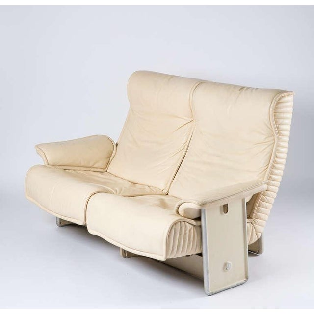 """""""Follow Me"""" leather settee by Otto Zapf for Knoll. """"The unitized seat and backrest of the """"Follow me"""" sofa glide smoothly..."""