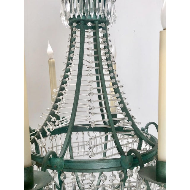 An early 20th Century Swedish crystal and metal with later green paint chandelier, circa 1920.