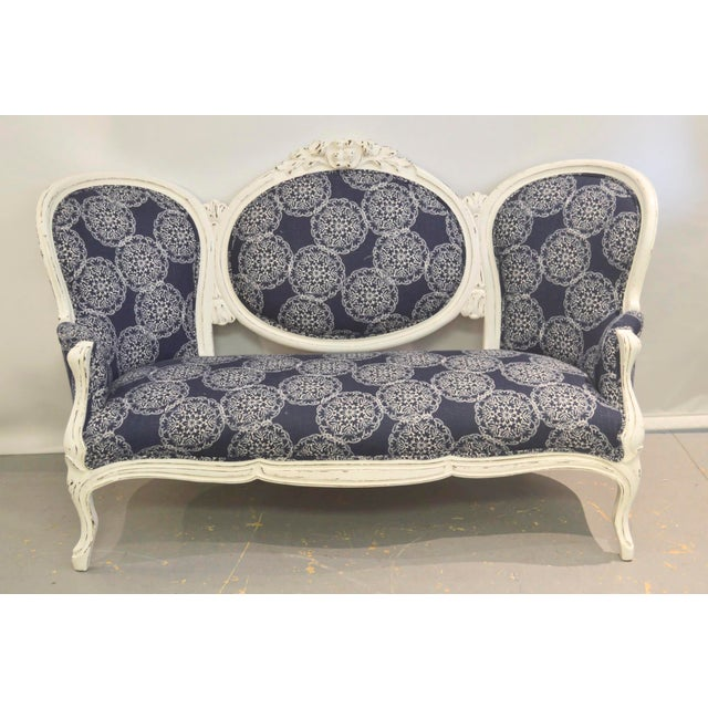 Vintage settee has a carved wood frame that has been painted white and distressed. Upholstered in a suzani print John...