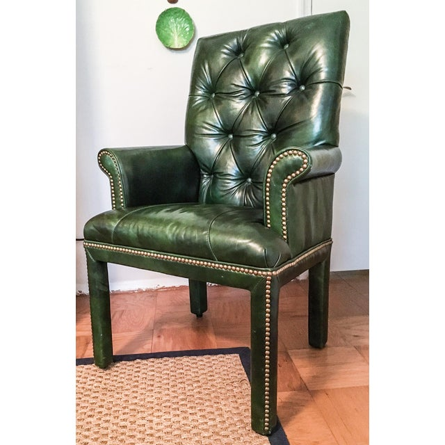 Fabulous tufted leather armchair by Michael Thomas Furniture, fully upholstered over a hardwood frame in a sensuous...
