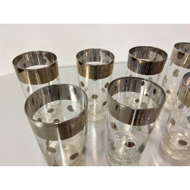 Mid-Century Dorothy Thorpe highly collectible set of silver polka dot tumbler glasses. Includes 9 high ball glasses and...