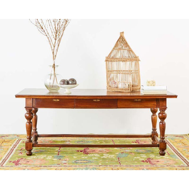 Large English farmhouse table, library table, or work table made in the country or Provincial style. Features a large...