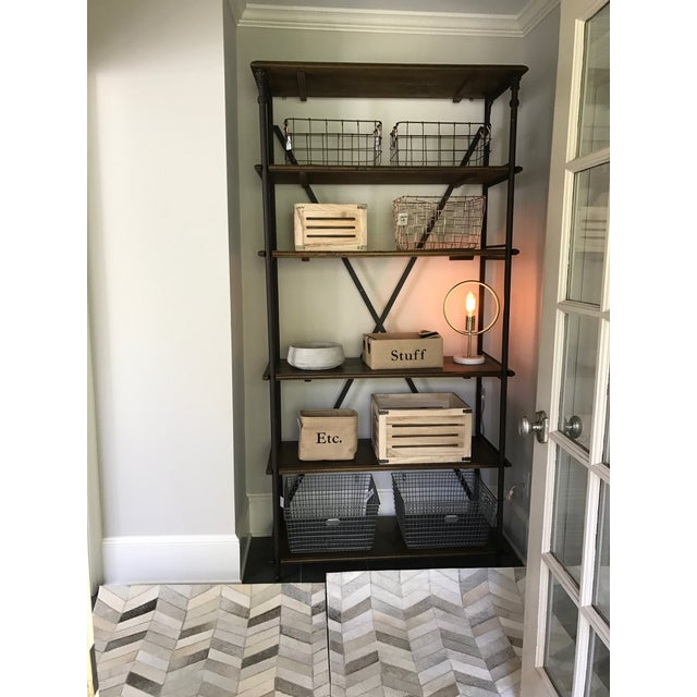 Industrial French style Tall Bookcase from Ballard Designs with iron posts and solid mango wood shelves. Not only super...