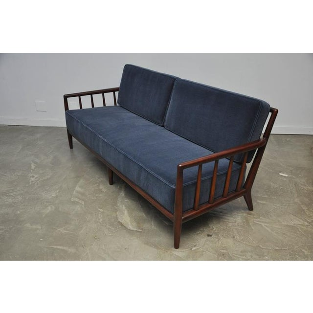 Walnut frame sofa by T.H. Robsjohn-Gibbings. Fully restored, refinished and reupholstered in dark blue mohair.