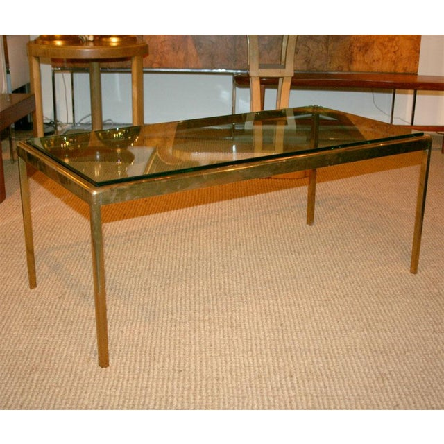 """A finely constructed bronze base cocktail table with a 3/4"""" thick glass top. By Kibrel S. Terry for Scope Furniture...."""
