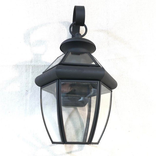 Livex Monterey 1-Light Outdoor Lantern Wall Sconce - Showroom Sample This outdoor lantern wall light is constructed of...