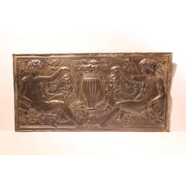 Antique American decorative figural tin wall panel.