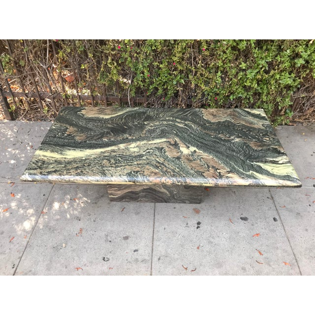 Rare and highly figured solid marble coffee table. Amazing black, grey, rust, and cream color veining (see closeup shots...