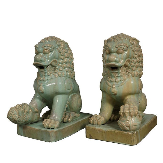 Look at this pair of magnificent Chinese Antique Porcelain Lions/Foo Dogs Statuary. they are hand made and hand carved...