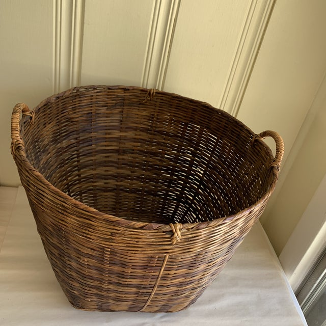 Rustic woven bamboo and natural wood decor and storage basket with side handles and bamboo bottom. Excellent size for all...