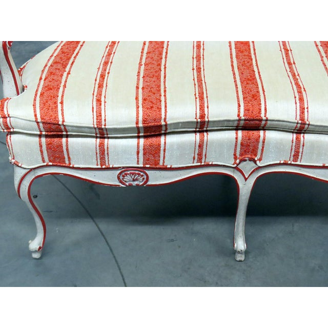 W&J Sloane Louis XV style settee with a distressed painted finish and a caned back.