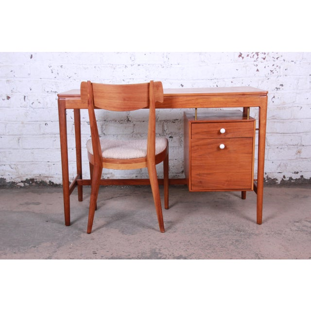 Offering an exceptional mid-century modern walnut desk and chair designed by Kipp Stewart for his Declaration line for...