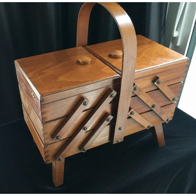 Constructed from sturdy beech wood and finished with a clear, hard-wearing varnish, this handy storage box features a...