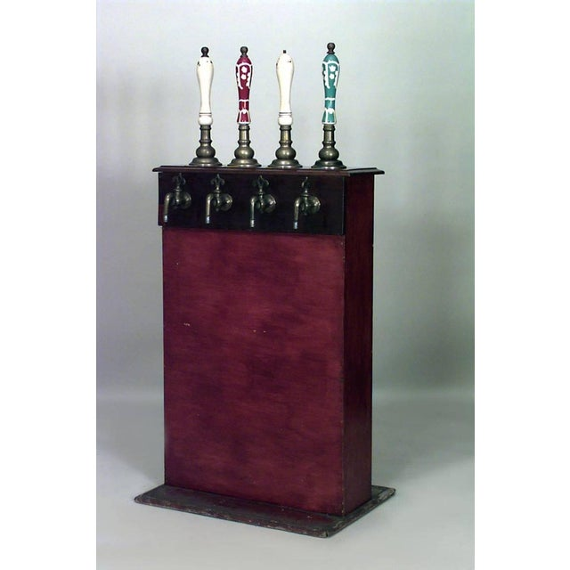 Nineteenth century English pub beer engine with a rectilinear wooden stand topped with four brass and porcelain spigots,...