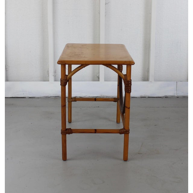 A vintage classic. Single darker-toned, curved rung adds contrasting detail. Solid wood top; slight wear due to age. Wide...